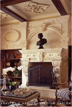 #fireplace Elaborate stone carved fireplace in gorgeous traditional living room