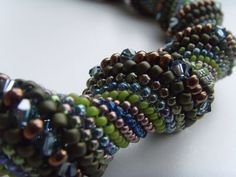 One of my favorite stitches. I like the idea of incorporating other beads into a pathway of one of the spiral rows.