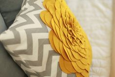 I'm a little obsessed with pillows right now. This chevron pattern with gray and yellow combo in killer.
