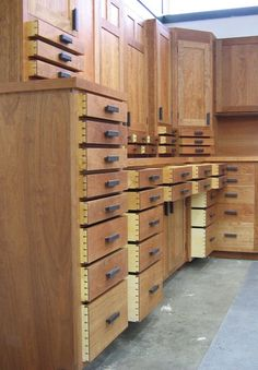 Oh yes, it shall be mine...  Gorgeous cabinets, complete with hand-cut dovetail drawers. Incredible craftsmanship! These ain't your cabinets from HomoDepo.