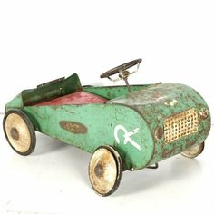 "A vintage ""Racerkar"" pedal car. This children's pedal car is comprised of metal and presented in green with white and black wheels, and a red vinyl seat cushion.The car includes two steel pedals to. Metal Toys, Tin Toys, Wood Toys, Children's Toys, Antique Toys, Vintage Toys, Vintage Metal, Vintage Art, E Motor"
