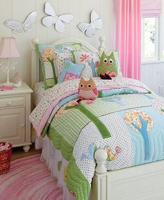 Pottery Barn Kids - owl bedding -  i'm not a huge fan of the owl fashion at the moment but I do think it would make a very cute nursery or child's room!