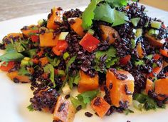 Forbidden Rice Salad with Orange Ginger Vinegrette        * 2 1/2 cups black rice       * 1 red bell pepper - rough chop      * 4 scallions, sliced      * 1 sweet potato, cut into small cubes, steamed until fork tender      * 1/2 cup to 3/4 cup cilantro, chopped roughly       1. Cook the black rice similar to brown rice. . Set it aside to cool. (Can make the night before and refrigerate)
