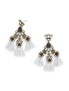 Make a boho luxe statement in these fringed statement drops, featuring a muted color palette.