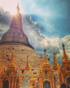 The #rainclouds pass and the #sun returns in an almost ethereal way as it beams down over the magnificent #shwedagonpagoda in #Yangon. There was still scaffolding at the top of the #pagoda when this photo was taken, but still the overwhelming #gold shone through. #shwedagon #Myanmar #Burma #Asia #souheastasia #travel #travelblog #instatravel #religion #spiritual #clouds #sky #temple #iphonepics