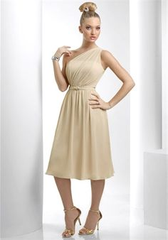 Dress features one-shoulder neckline and brooch.