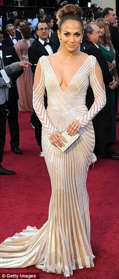 Jennifer Lopez in her dramatic cream gown by Zuhair Murad    May be late but I loved this dress. I like that she made the dress the center and didn't add a lot of accessories.
