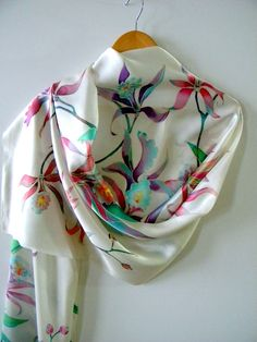 Gorgeous hand painted silk scarf with Orchids flowers . The author handpainted in cold batik technique on natural silk satin  size 79 by 17 200 cm by 42 cm  Edge scarf neatly sutured manually. Hand wash delicate mild detergent in warm water. You can iron it on silk settings. Emphasize your femininity and individuality. This item may be worn with casual wear and special occasions. Everything made by me unique and made in one piece. To the order, I can do a similar thing, but not an exact…