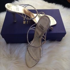 Stuart Weitzman Heels Gently used Stuart Weitzman heels perfect for your wedding or an evening out. Surprisingly comfortable golden heels with braided kid leather and crystal accents. Please note that a few crystals are missing as shown in photo...but you really need to be that close to notice. Original box is included. Stuart Weitzman Shoes Heels