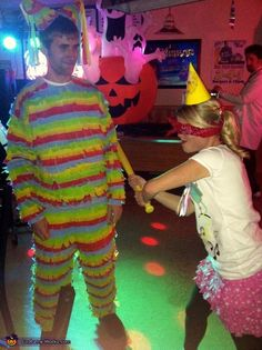 Pinata and Birthday Girl. For the couple with the love-hate relationship.  Needed: Crepe paper, fabric glue, shirt and pants, party hat, blindfold and a wiffle bat (be gentle!) #halloween #couplescostumes