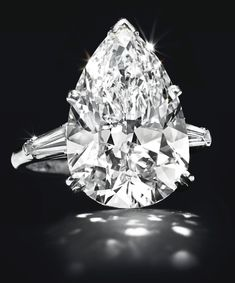 Diamonds Sparkle at Christie's Opening Luxury Week Auction. This 14.82-carat, pear-shaped E color VVS2 diamond  sold above its estimate for nearly $1.6 million, or $107,500 per carat.