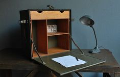 For the expedition Base Camp:  1944 U.S. Army Field Officer's Desk.  With Key.  Period style lamp necessary, but not included.  On Etsy.