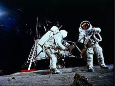 Astronaut Neil A. Armstrong, wearing an Extravehicular Mobility Unit, participates in a simulation of deploying and using lunar tools on the surface of the moon during a training exercise in bldg 9 on April 22, 1969. Armstrong is the commander of the Apollo 11 lunar landing mission.
