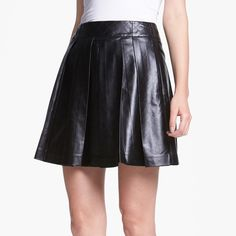 """NWT Mcginn Faux Leather Skirt Skirt. Cross hatched seams define the banded waist topping a full, pleated skirt cut from slick black faux leather. Back zip closure. Two front pockets. Unlined. Black color. 17"""" length. 100% polyurethane. Spot clean. NWT. No trades. Mcginn Skirts"""
