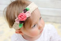 Finishing Cut a 2″ piece of elastic. Folding the raw edge over on each side of elastic, hand sew it to the headband as pictured. Repeat on the other side. Arrange the flowers in a way that makes you happy and hand sew them to your headband.