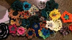 Crochet Flowers made & donated by Ashley, of Ashelizzy Crafts, for Bow Dazzling for delivery to local hospitals.   She thoughtfully left tails to sew flowers to headbands. Bow Dazzling is a nonprofit providing smiles and encouragement to girls receiving treatment for cancer and other life threatening illnesses.  http://facebook.com/BowDazzling