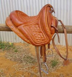Maremma saddle from Italy. It is treeless - instead the leather is heavily stuffed with padding. The quilted floral pattern on the seat adds a decorative touch.