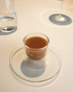 Hot & cold rabbit broth. It's hard to imagine but the left side of the cup was filled with cold broth while the right side is with hot broth. It stays apart and there is an interesting temperature sensation when you consume it. by alastiar_tan