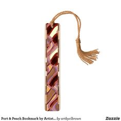 """Tuck this beautiful wooden bookmark in between the pages of your favorite read. The Port & Peach Bookmark designed by Artist C.L. Brown features an abstract kinetic light painting edited for design. The bookmark is handcrafted with unique wood inlays and a selection process that guarantees beautiful wood variation in every bookmark. Made in the USA using sustainably harvested woods with dimensions of 1"""" x 6"""". This product is recommended for ages 6+. Makes the perfect gift for the bibliophile…"""