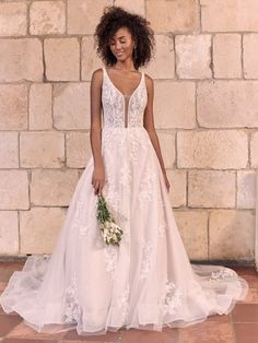 Romantic & sexy, this gown is complete with a plunge illusion neckline, lace appliques and a full ballgown style skirt with a horsehair trim. A Line Bridal Gowns, Bridal Dresses, Wedding Gowns, Bridesmaid Dresses, Wedding Dress Brands, Halle, Bridal Looks, Bridal Style, Champagne Gown