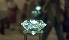 The Victoria sits elevated on an acrylic stand. From the very beginning an aura of mystery surrounded the discovery of this gem, which weighed 457½ (old) carats in the rough. Also called the 'Imperial' or 'Great White', it remained the biggest octahedral diamond crystal from South Africa until 1896 when it was surpassed by one weighing 503¼ (old) carats that was found in the De Beers Mine.