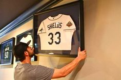 James Shields takes down the jersey he wore during the 2008 World Series. He started the only game the Rays won. Big Game James was traded to the Kansas City Royals.  We will miss you.