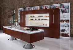 Kitchen How to Pick out a Kitchen Cabinet Style: Attractive Modern Kitchen Design With Brown Kitchen Cabinet And Bookcase And Table Kitchen And Washbasin And White Laminating Floor