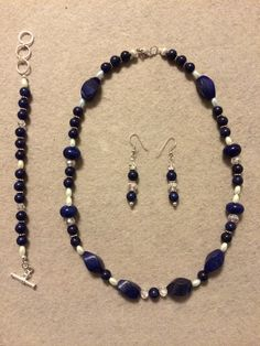 The Melissa Collection features a delightful mixture of Navy Blue Swirl beads, Navy Blue Round Pearls, Navy Blue Round beads, White Oval beads, Silver Corrugated beads, and Silver Daisy Spacers. Navy Blue rules the day!! Melissa A