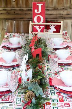 Red and white country Christmas tablescape inspiration (with items sourced from Target and Amazon!) TIP: Instead of pulling out the fancy linen, use Christmas wrapping paper to decorate your table ~ it's cheaper and easy on the clean-up process. Instead of dropping linen into the washer, you can just roll this up and toss it.