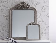 Exquisite vintage style mirror with a beautiful crest design in signature Brissi Grey. Hand-distressed grey patina - looks just like a true vintage find! Shop it at Brissi.com #vintagemirror #crest #shabbychic