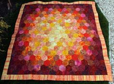 """From PingWynny Gillian: """"I hand pieced the hexagons and machine quilted. I just love making hexagon quilts, I find it very calming to sit and hand sew and makes a nice change as most of my quilts are machine stitched."""""""