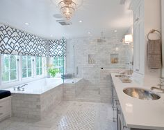 that tub/ shower combo is to die for.  Plus the hammered metal sinks- so cool