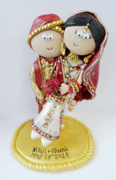 Indian Groom carrying his Bride, this topper would be £149.99 for the couple £9.99 for the base. I make them from scratch to look like you, all aspects of the couple are included in the price & you can have 2 small props to show jobs, hobbies i.e. mobile phone, shopping bags, laptop etc. I ship World wide. www.indian-wedding-cake-toppers.com #indianwedding