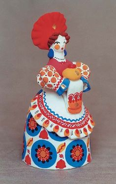 Traditional Dymkovo toy is a hand-painted clay toy from the Russian village of Dymkovo. Lady holding a festive loaf. #folk #art