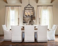 Slipcovered dining chairs create a tailored look in this transitional dining room decor. Dining Room Chair Slipcovers, Dining Room Chair Covers, Dining Room Chairs, Dining Room Furniture, Chair Cushions, Dining Room Curtains, Ikea Dining, Dining Table, Curtains Living