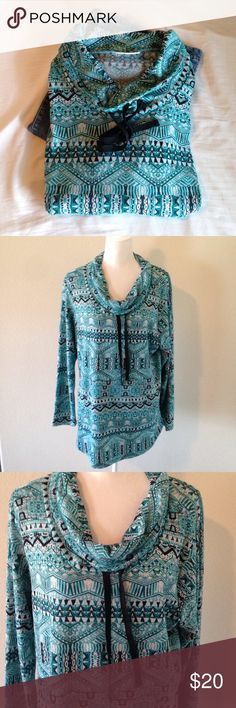 "Patterned tunic NWOT Teal and black patterned tunic. Cowl neck/ drawstring. One front lower pocket. Light weight. New without tags. 95% polyester. 5% spandex. Approx measurements. Bust 23 1/2 "" length 29"" Tops Tunics"