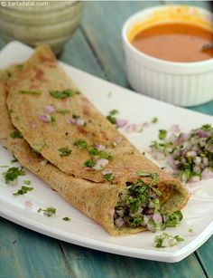 The stuffing of onions, coriander and green chillies adds to the appeal of the Whole Moong Dosa, both in terms of flavour and texture. Moong with its rich fibre content helps lower cholesterol levels and gives the dosa a mild and enjoyable crunch.