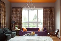 Contemporary Living Room with lots of color.  Note the orange ceiling in the adjacent room which works with the fireplace.  And those light fixtures!!!