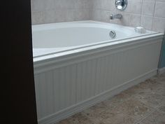 Just Another Day In Paradise: Master Bathroom Improvement - how to add beadboard skirt to bathtub