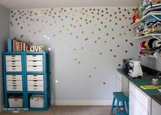 Use removable #vinyl as #wallpaper in your #apartment! Love the #gold #metal dots!