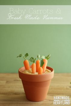 """Fresh made hummus & baby carrots """"growing"""" out of terracotta pots. so cute and so easy! Perfect Easter appetizer. HandmadeintheHeartland.com"""