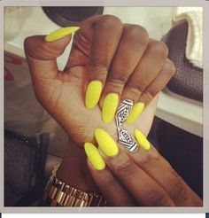 Bright stiletto nails.