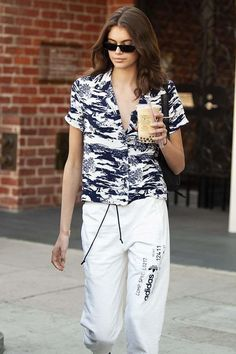 4508d3c69b2e Spott - Kaia Gerber grabs coffee dressed in a The Reformation top and  Adidas x Alexander Wang sweatpants Model Streetwear
