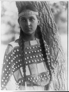Lucille, a Young Native American Girl. It was taken in 1907 by Edward S. The image shows Lucille in a half-length portrait, standing next to a tree, facing front, wearing a headband and seashell decorated buckskin dress. Native American Girls, Native American Beauty, Native American Photos, Native American Tribes, Native American History, American Indians, American Indian Girl, American Symbols, Native Indian
