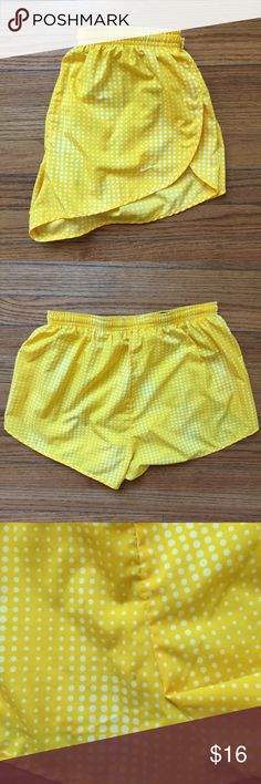 Nike Dri-Fit Running Shorts Like new condition! Cute yellow circle pattern for summer. One tiny spot on back but not noticeable at all. Looks like it was from a pencil or something Nike Shorts