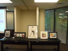 Display featuring the five finalists in the 2013 Congressional Art Competition.