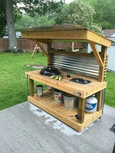 This would be Awesome in the backyard and pretty simple to put together! Corrugated metal top and backing, insert a 2 or 3 burner gas stove, put casters on the feet to be able to move it around, if needed.  Photo Credit: pinterest.se/pin/440508407285978940/