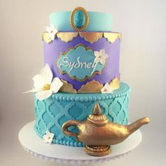 Multi-tier cake in teal and purple with Jeanie's lamp and flowers. Jasmine Birthday Cake, Aladdin Birthday Party, Aladdin Party, Cake Birthday, 5th Birthday, Birthday Ideas, Princess Jasmine Cake, Shimmer And Shine Cake, Jasmin Party