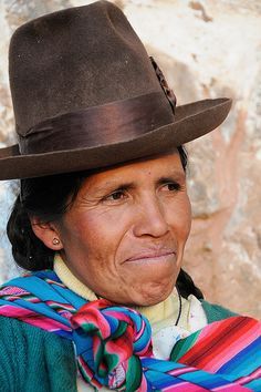 South America | Portrait of a Aymara woman wearing a traditional hat, Peru | © Ian Cowe