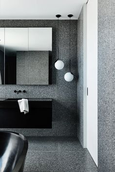 The word 'monochrome' gets bandied about a lot in interiors, and indeed, the duo-tonal black and white palette is one that is often employed. Terrazzo